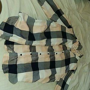 A checkerd button up shirt.